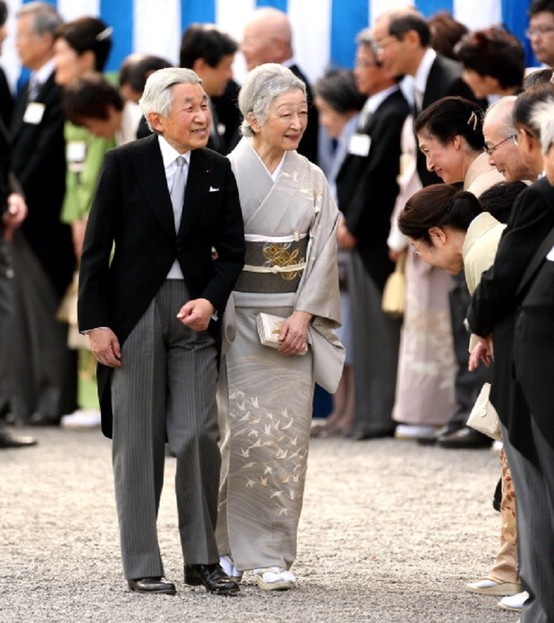 Emperor Akihito (1933-living2013) Japan & Empress Michiko Shōda (1934-living2013) Japan, greet guests during the annual spring garden party at Akasaka Palace on April 2013 by photographer Unknown. Akihito is 5th child of Emperor Hirohito (now Emperor Shōwa) (1901-1989) Japan & Empress Nagako (now Empress Kōjun) (1903-2000) Japan. Michiko Shōda is the Child of Mr. Hidesaburo Shōda (1904-1999) Japan & Fumiko Soejima (1910-1988) Japan. Michiko is the 1st non-royal to marry a Japan Emperor.