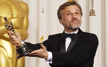 Austrian actor Christoph Waltz, best supporting actor winner for Inglourious Basterds celebrates with his Oscar backstage and he won another for Django Unchained. Two fantastic films.