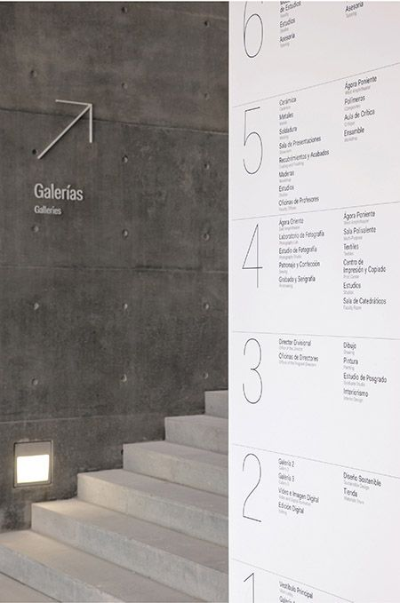 In contrast to the building's rough concrete, the environmental graphics appear in shiny, smooth materials, like this directory made of Corian.