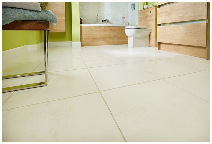 Large format crema canaletto floor tiles are a neat and practical choice #bathroomfurniture