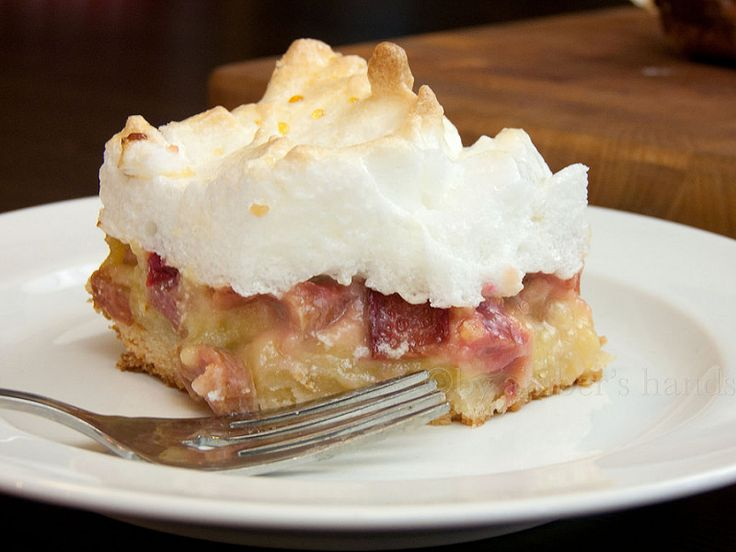 {Rhubarb Meringue Bars} A shortbread crust topped with a sweet & tangy rhubarb custard, finished off with pillowy meringue on top.