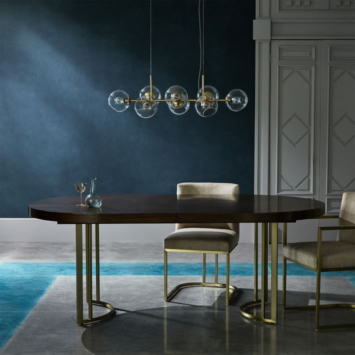 juxtaposing a sculptural stainless steel base with a softly rounded tabletop our court table takes center stage in any dining space its expandable design