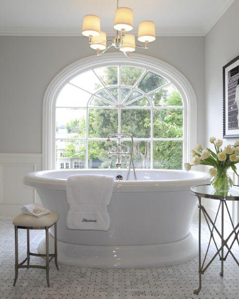LOVE this gorgeous bathtub & the big beautiful window!!!! Very nice.