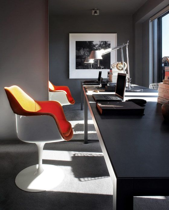 Saarinen Tulip Chairs paired with a visually expansive desk via mirror placement; Katon Redgen Mathieson