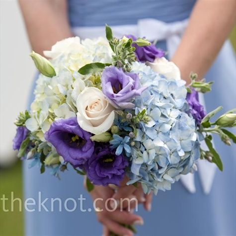 The six bridesmaids carried arrangements of hydrangeas, roses, lisianthus, and tweedia, which complemented their full-length periwinkle dresses with white sashes.