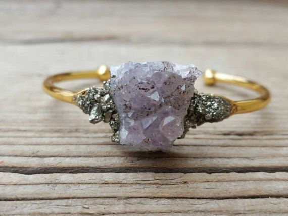 """This perfectly imperfect bracelet, <a href=""""https://go.redirectingat.com?id=74679X1524629&sref=https%3A%2F%2Fwww.buzzfeed.com%2Failbhemalone%2Fbirthstones-for-all&url=https%3A%2F%2Fwww.etsy.com%2Fuk%2Flisting%2F496684502%2Fraw-amethyst-crystal-amythest-bracelet%3Fga_order%3Dmost_relevant%26amp%3Bga_search_type%3Dall%26amp%3Bga_view_type%3Dgallery%26amp%3Bga_search_query%3Damythest%26amp%3Bref%3Dsr_gallery_29&xcust=4461919%7CAMP&xs=1"""" target=""""_blank"""">£25</a>"""