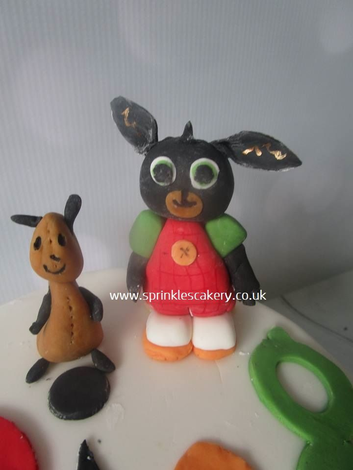 A couple of edible CBeebies favourites; Bing and Flop made in fondant and modelling paste.