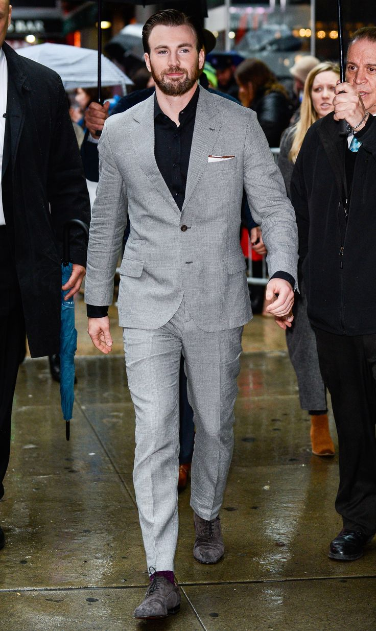 The 10 Best-Dressed Men of the Week 4.10.17 Photos | GQ, Chris Evans Toggle WHERE: On the street in New York City WHEN: April 6, 2017  WHY: Because this is how you give a dove gray suit some edge (that would be with a jet black shirt and dark suede shoes).