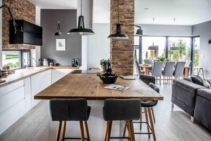 This living room, dining area and kitchen was designed open plan but the area are well separated with furniture