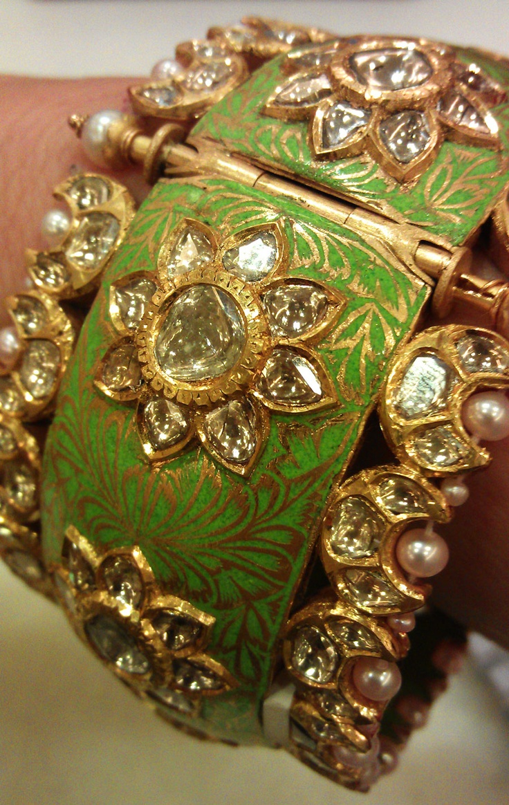 Trying on Sunita Shekhawats beautiful enamel and rose-cut diamond bangle in her showroom in Jaipur.