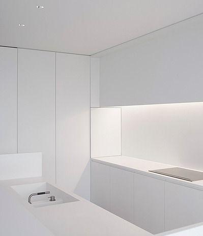 Minimal white Corian kitchen by Pascal Bilquin & Minus architects _