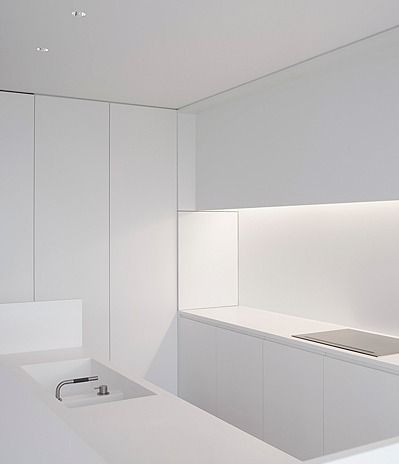 Minimal white Corian kitchen, by architect Pascal Bilquin. Interior execution by Minus.