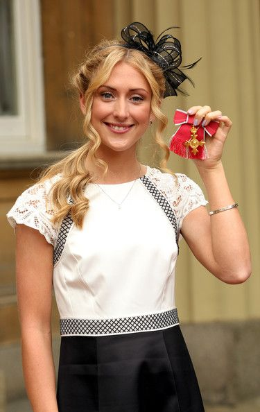 Laura Trott Photos - British Olympic cyclist Laura Trott after receiving her OBE medal from the Prince of Wales at an Investiture ceremony at…