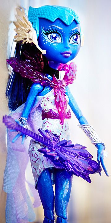 Astravova Boo York, Boo York Monster High Doll, 2015 (I have her.) - She is a comet alien. Her freaky flaw is that after traveling for lightyears, she sometimes has difficulty navigating Monster High; and what she's trying to say sometimes gets lost in translation. Her favorite activity is singing. In her sense of style she loves glam rock. The more sparkle and out-of-this-world shine the better. Her pet peeve is when other monsters ask her what planet she's from. She's from a comet.