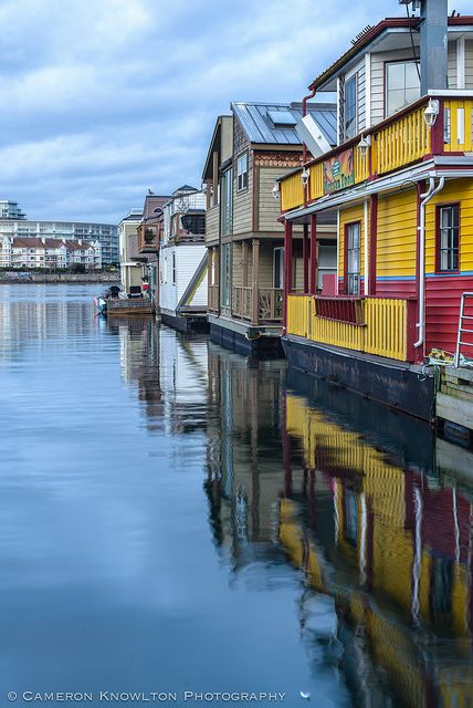 Fishermans Wharf, Victoria, BC, Canada. Just around the corner from Victoria's Inner Harbour, this spot is a hidden gem complete with food kiosks, unique shops and eco-tour adventures. Wander down the docks with your lunch, check out the colourful floating homes and buy seafood fresh off the boat! #exploreBC