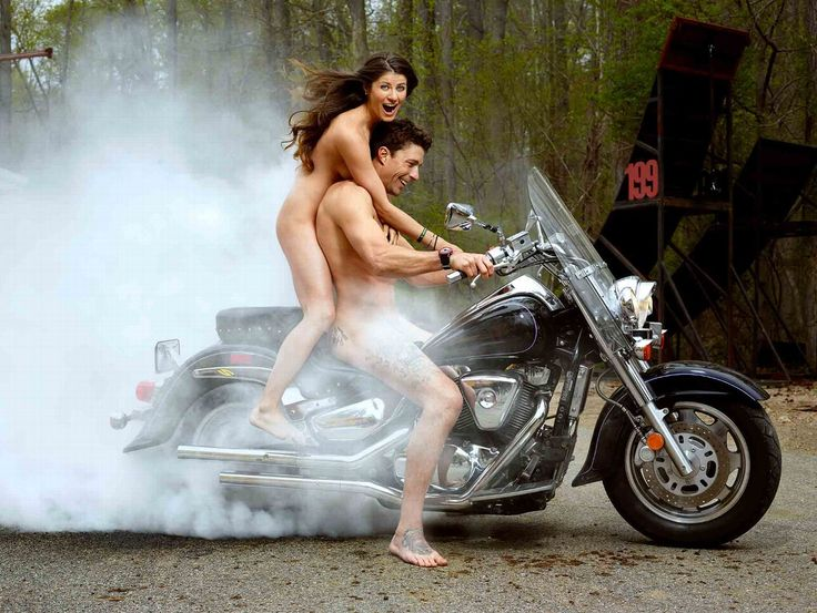 Nude female motorcycle rider