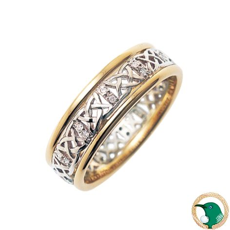 Our ladies Principle Diamond Celtic ring in 18ct yellow gold and white gold, with a white gold Celtic weave design which is accented by x18 .005ct diamonds (TDW .09ct). This is bordered by yellow half round shaped rails.