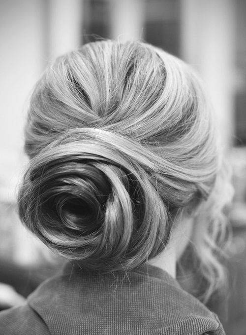 5 Hopelessly Romantic New Wedding Updo Ideas  I think my heart actually skipped a beat when I saw this rose-shaped bun on Pinterest earlier this week. It's so simple and elegant yet totally unique—and so perfect for a bride.