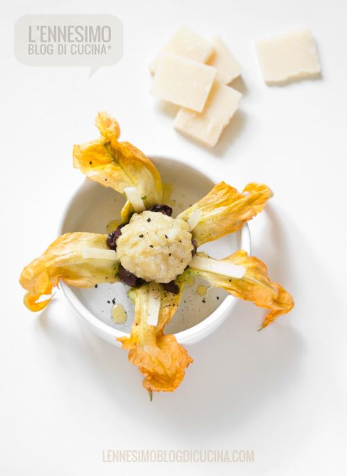 Parmigiano rice flowers (with zucchini flower and black olives)