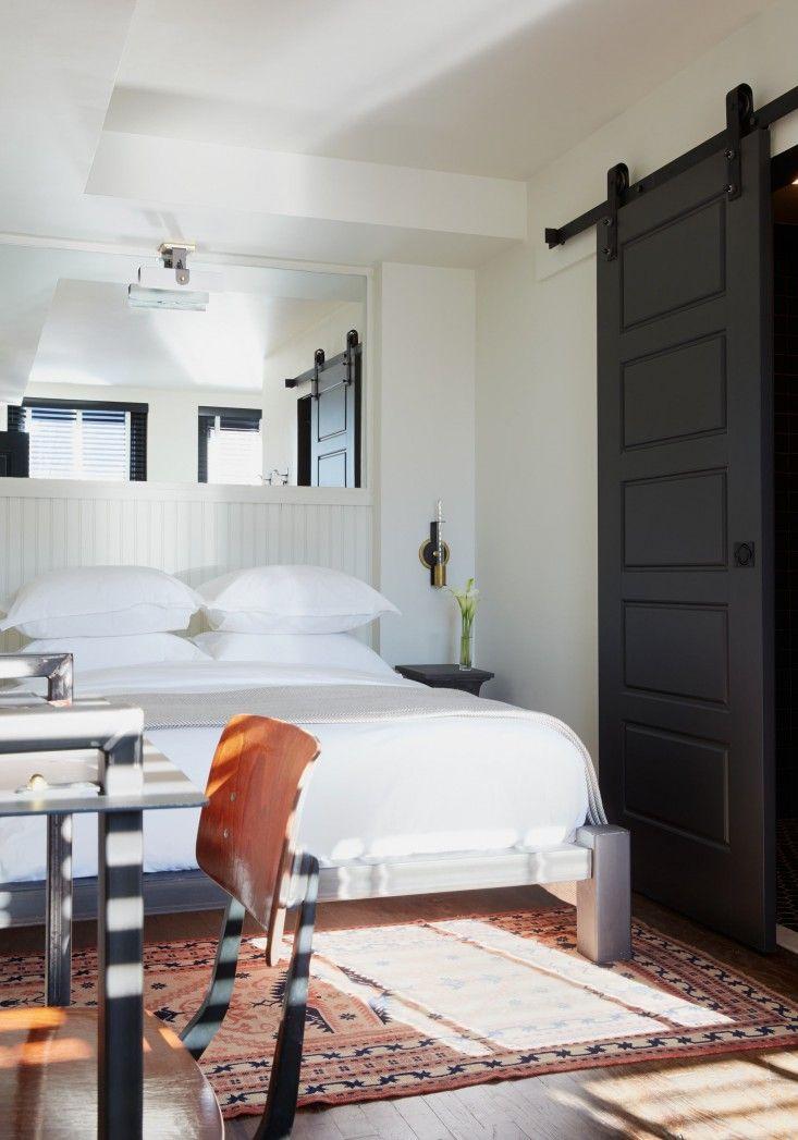 Bedroom with Black Barn Door in The Dean Hotel in Providence, Rhode Island   Remodelista