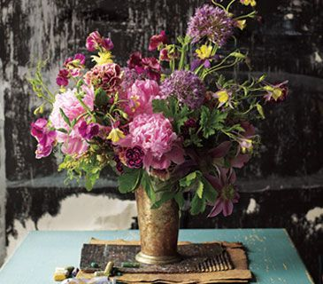 How to arrange flowers in a vase.