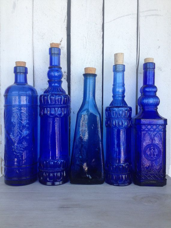 Blue glass bottle collection.