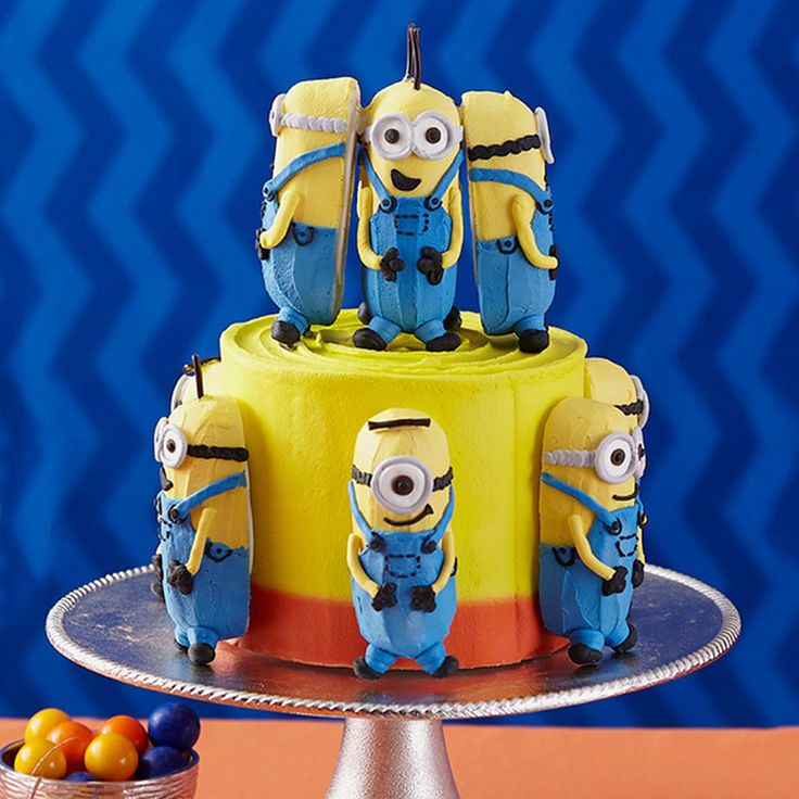 This cake is double the fun, because everyone gets a mini Minion cake to take home after the party! Bake extras in the Minions 12-Cavity Cake Pan so there will be enough for everyone to share.