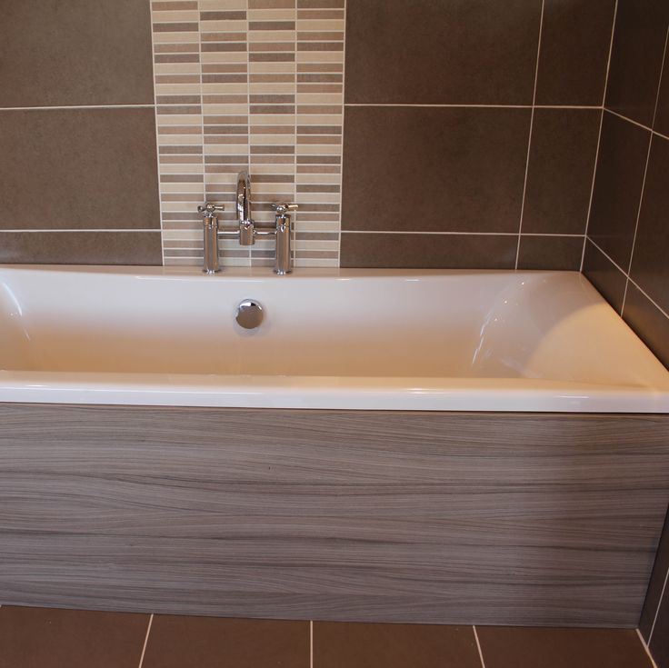 a brown coloured ceramic wall tile with a freckle travertine natural stone effect has