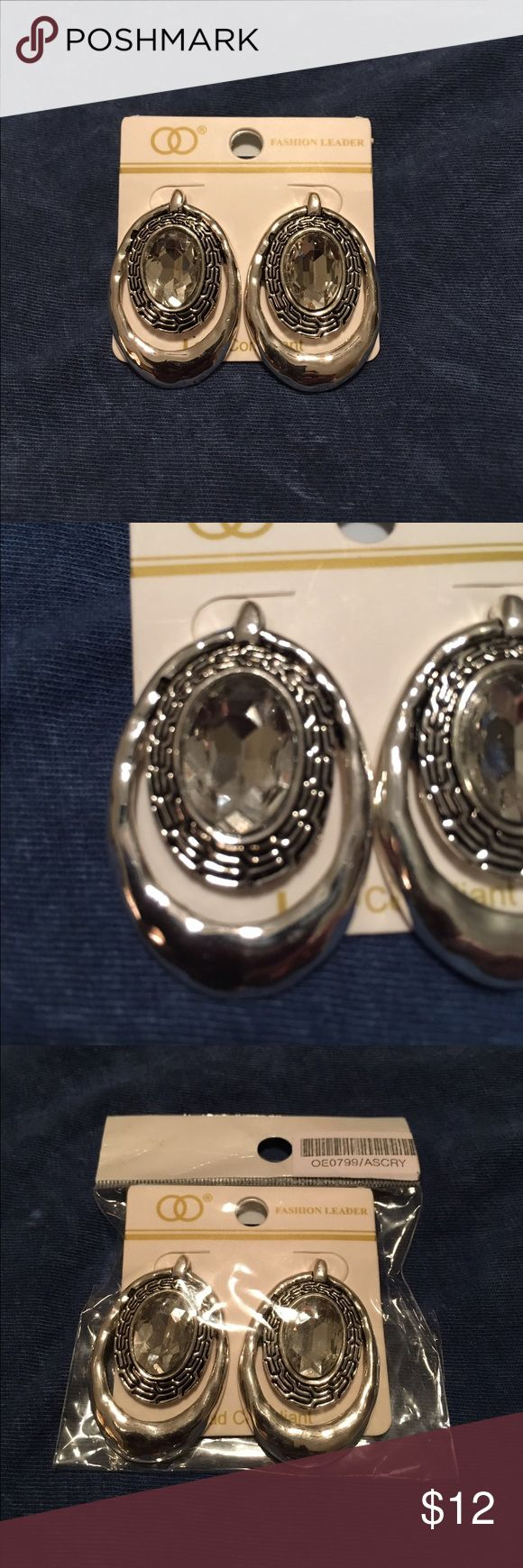 """Beautiful Silver Rhinestone Earrings This is a pair of new in the bag silver and rhinestone pierced earrings with a black inlayed design.  They have never been worn and are beautiful !  They measure about 1 1/2"""" in length. Jewelry Earrings"""