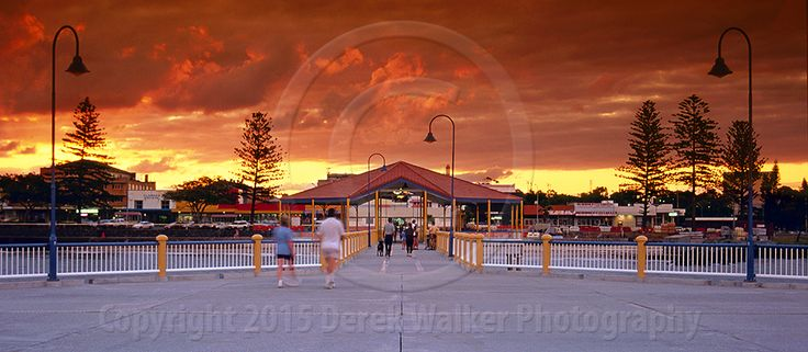Panorama looking west towards a firey sunset from the end of the Redcliffe jetty in Queensland's Moreton Bay, Australia.  For image licensing enquiries, please feel welcome to contact me at derekwalker73@bigpond.com  Cheers :)