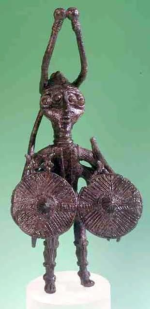 This is a bronze statuette of Shardana Sea People, 2nd millennium B.C.  [am sorry but this looks like an alien to me!!!]