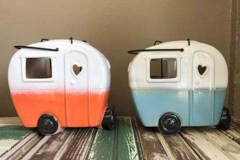 "So Cute!  Choose orange or blue, in these vintage style campers.  Each has a handle and a votive holder that can be easily lifted up and lit. Measures approx. 7"" x 3"" x 7""h"