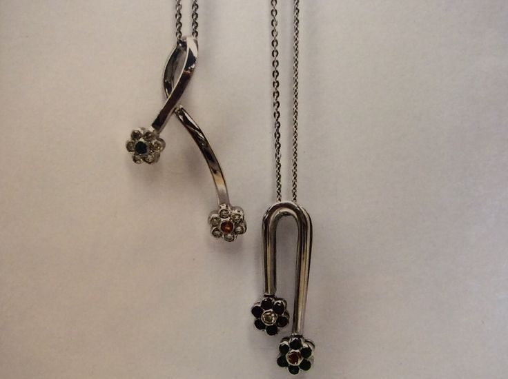 """""""For get me not"""" pendants set with black and white diamonds"""