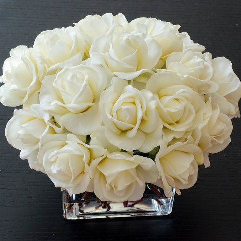 """When it comes to roses, there is never the word """"enough"""". This faux floral arrangement features many many white real touch roses and it's perfect for home decor, wedding centerpiece or event use. The roses look like they are hand-picked from the garden and arranged carefully in this..."""