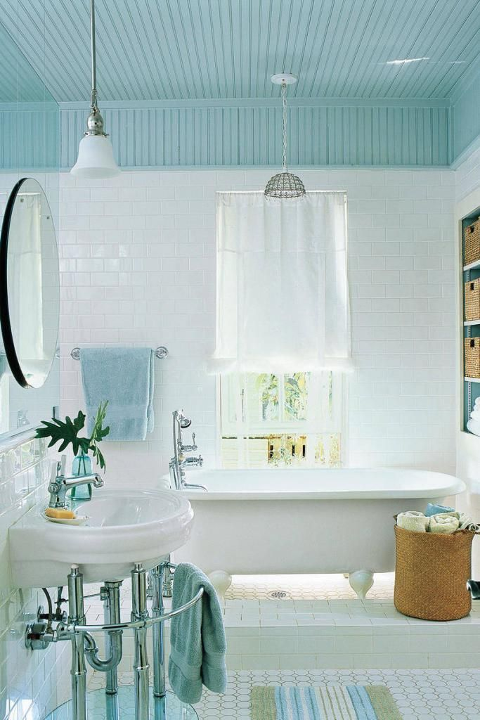 Traditional Blue Bathroom With Light Blue Ceiling And White Tile