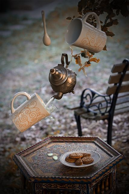 A tea arranged itself before her eyes, pouring through the air; sugar and milk swirled into cups. The result was a domestic arrangement layed for two.