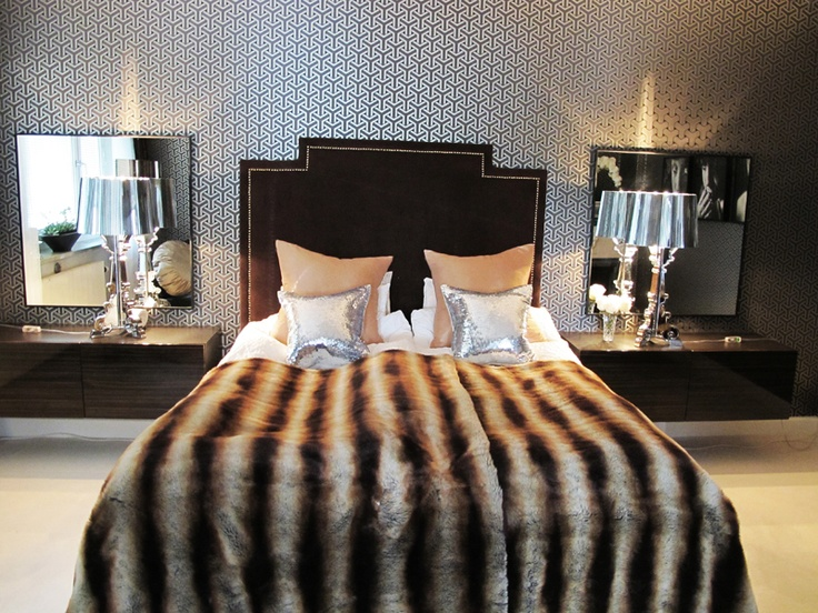 Faux fur throws and brown velvet headboard in bedroom for Decor glamour