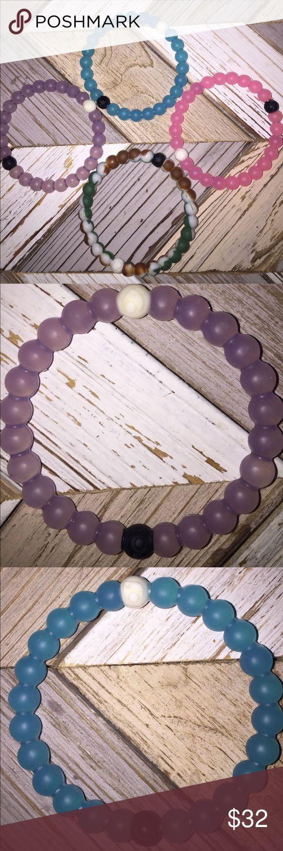 Pink, purple, blue, and camouflage Lokai bracelets Lightly worn! Perfect condition! All four come with purchase! Each are a size Medium! Lokai Jewelry Bracelets
