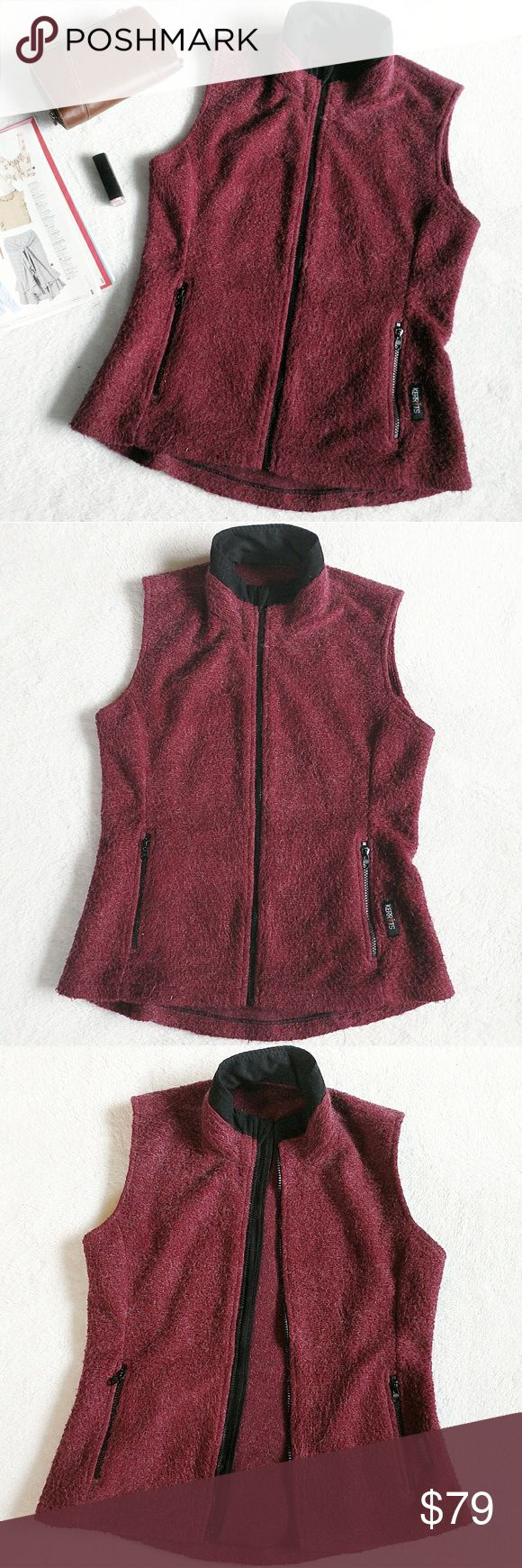 Kerrits Equestrian Fuzzy Maroon Vest Maroon Fuzzy Vest by Kerrits.  Has soft, fuzzy maroon fabric with occasional lighter threads.  Has a black exposed zipper down the front, at the neck there is a flap of fabric that hides the zipper pull   Has a black high neck color   Has two pockets with black exposed zippers  Made to be an equestrian, horse riding vest but would also be good for hiking, travelling or as a fashion vest   Zipper pulls on each zipper have some wearing, shown in the last…