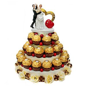 3 tier Ferrero Rocher chocolate tower decorated beautifully with artificial flowers and berries. http://www.tajonline.com/valentines-day-gifts/product/v3329/romance-with-chocolates/?Aff=pint2014/