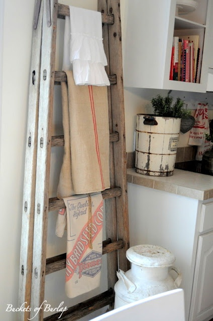 I love the old ladder as a tea towel holder.