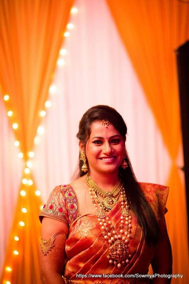 Traditional South Indian bride wearing bridal saree and jewellery. Reception look
