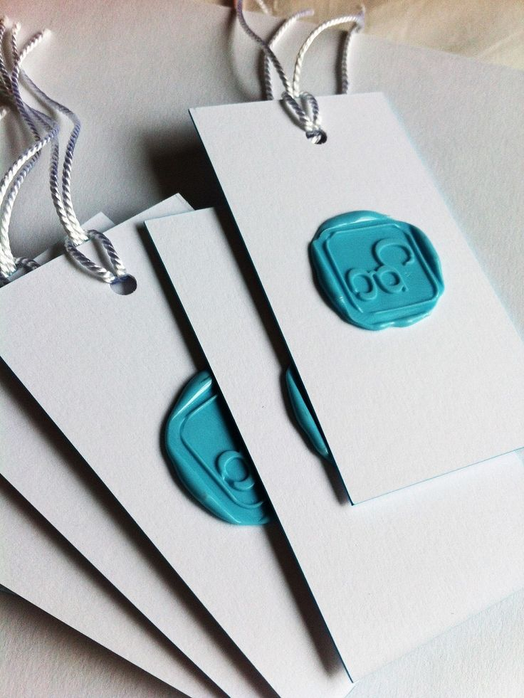 chartwellandg swing tags - handmade using GF Smith Colorplan paper and a custom-made wax seal. chartwellandg is a British luxury resort wear brand.