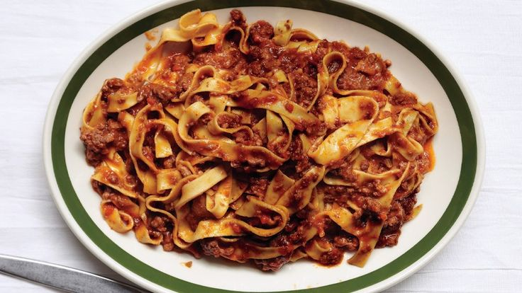 A certain magic happens as the beef and aromatic vegetables slowly cook down with wine, tomato paste, and broth in this classic bolognese recipe.