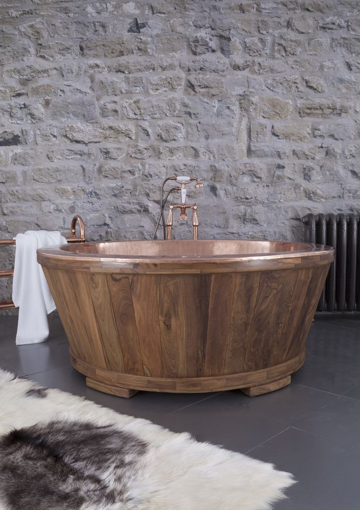 The Dory - a true centre piece! Our copper tub clad in Teak or Fruit Wood. #hurlinghambaths #tubs