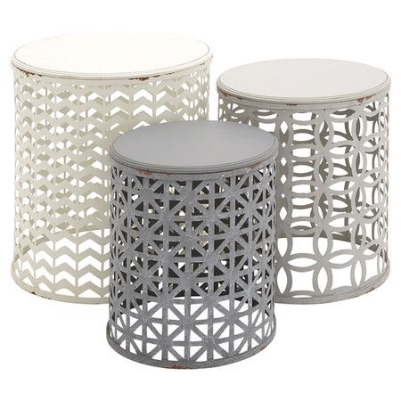 Stagger these metal end tables to create an eye-catching display or set them throughout your home for a cohesive touch. Showcasing openwork designs and neutr...