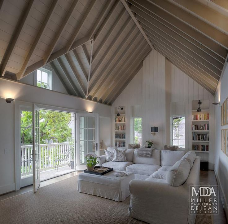 Fabulous family room features cathedral ceiling accented