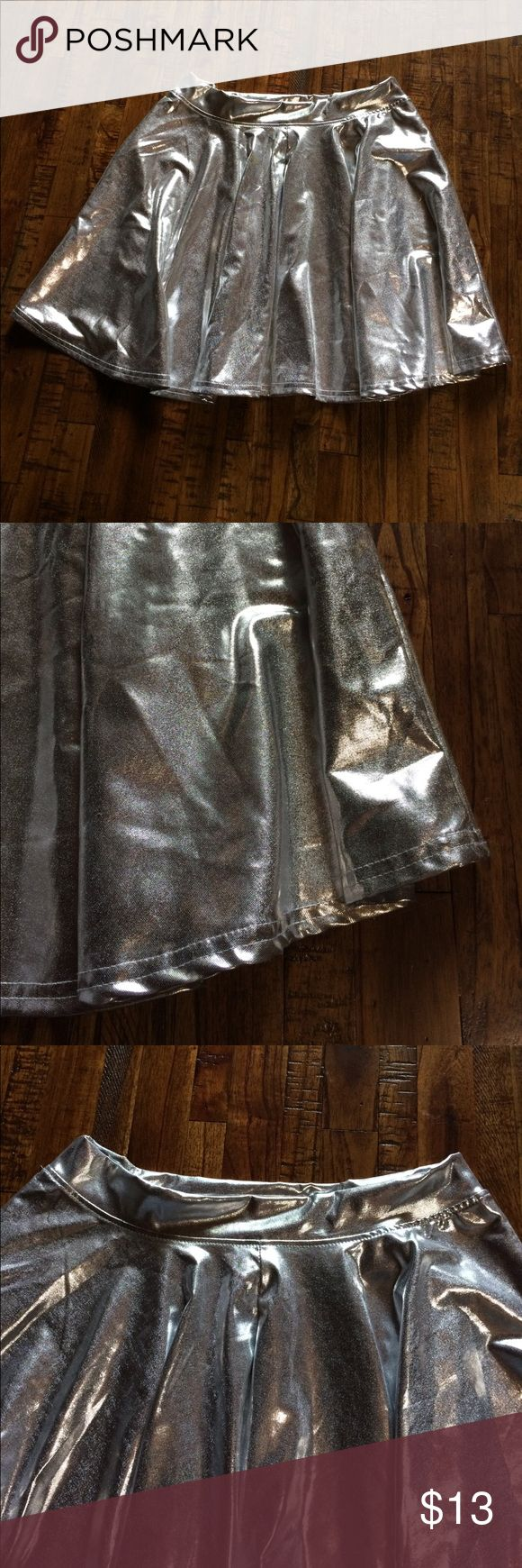 Gattaca Skirt Wear this to your next EDM festival or dress up as a space girl for Halloween! Space silver skater skirt in excellent condition. Fits Small at best and the perfect length without being too short. Measures 14 in from bottom of waistband to hem. Brand is HDE. HDE Skirts Circle & Skater