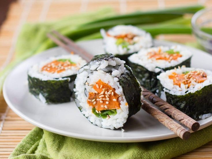 Sweet potatoes are roasted with maple syrup and sesame oil and rolled in rice coated nori sheets to make these flavorful sweet potato sushi rolls.