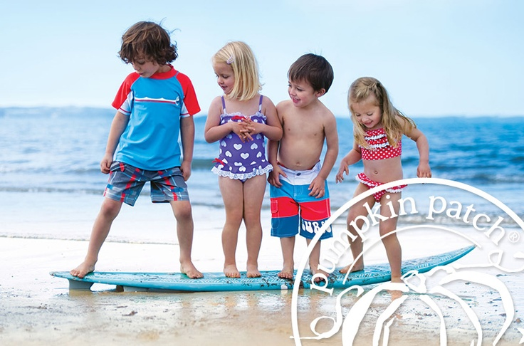 Our gorgeous Patch models hang ten on the beach in their the Pumpkin Patch Summer 2012 swimwear styles.
